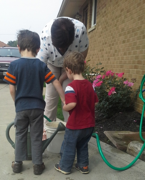 Good thing Nana loves them. Who else would help them water the driveway?